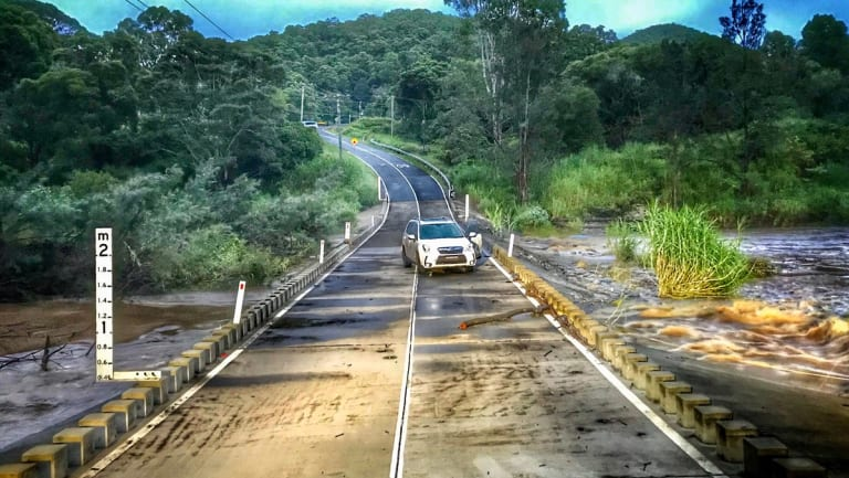A car still stranded on a Gold Coast road on Tuesday morning.