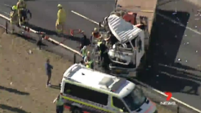 A driver is trapped inside a truck after a crash between multiple vehicles.