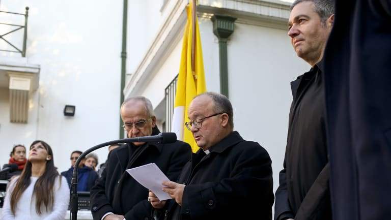 Archbishop Charles Scicluna, holding paper, Spanish Monsignor Jordi Bertomeu, right, and Papal Nuncio Ivo Scapolo, left, give a press conference in Santiago, Chile.