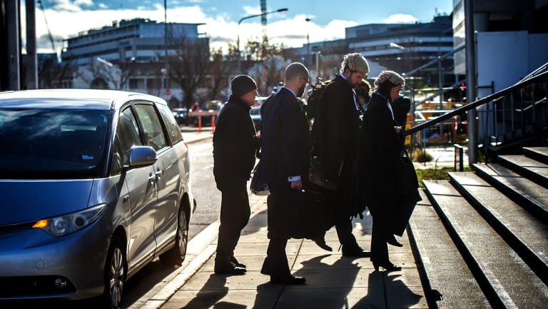 David Harold Eastman, far left, arrives at the ACT Supreme Court for his murder trial.