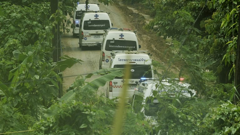 Five ambulances drive up the road leading to Tham Luang cave during the rescue operation.