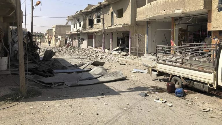 Houses and shops destroyed after shelling by Syrian government forces, in the town of Nawa, Syria.