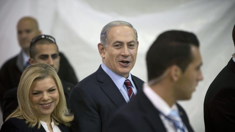 Israeli Prime Minister Benjamin Netanyahu, centre, and First lady Sara Netanyahu in Jerusalem.