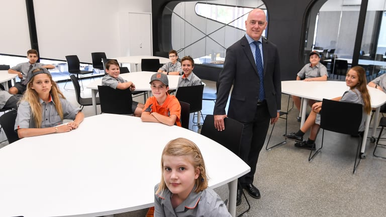 Principal Colin Simpson and students inside the new Richmond High