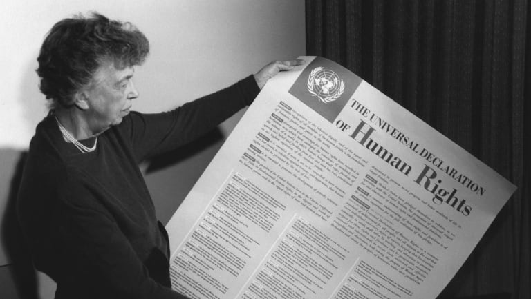 Eleanor Roosevelt holds the Universal Declaration of Human Rights,