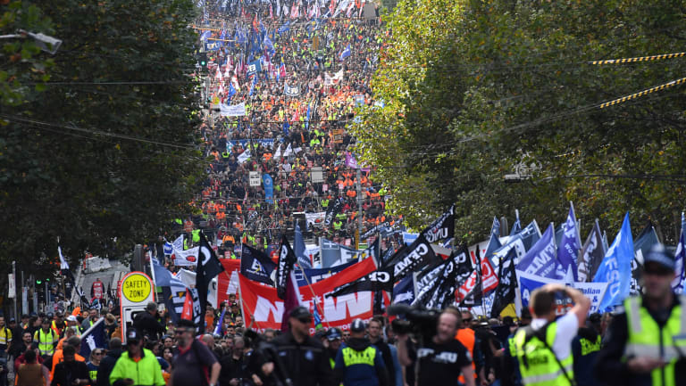 Workers filled LaTrobe Street as they make their way to the Magistrates Court.