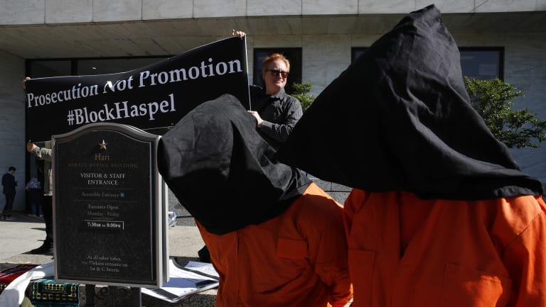 Demonstrators dressed as Guantanamo detainees to protest against Haskel's nomination.