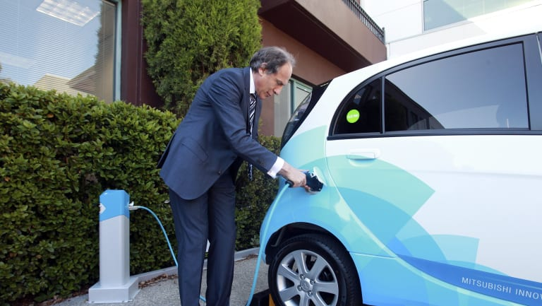 In praise of the transport revolution: Chief Scientist Alan Finkel with an electric car.