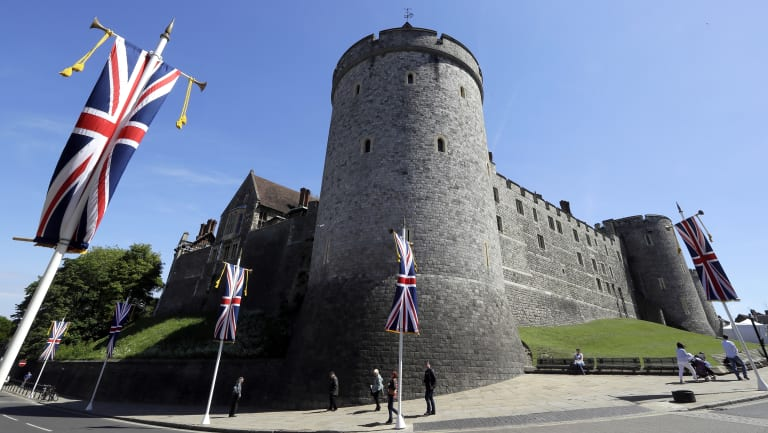 Flags fly in front of Windsor Castle's walls
