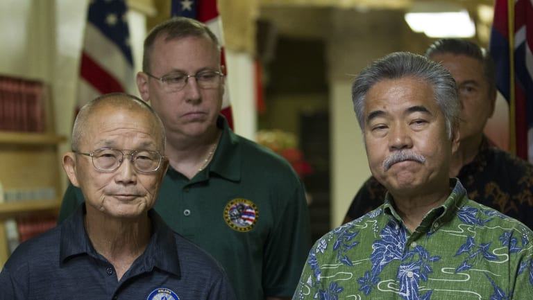 Hawaii Gov. David Ige (right) addresses the media after the false alert.