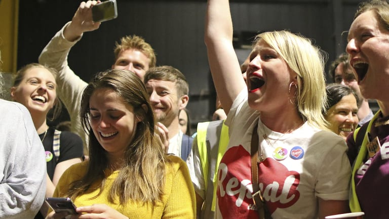 """People from the """"Yes"""" campaign react as the results of the votes begin to come in the Irish referendum on the 8th Amendment of the Irish Constitution."""