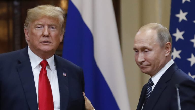 U.S. President Donald Trump, left, and Russian President Vladimir Putin leave after a press conference after their meeting at the Presidential Palace in Helsinki, Finland.