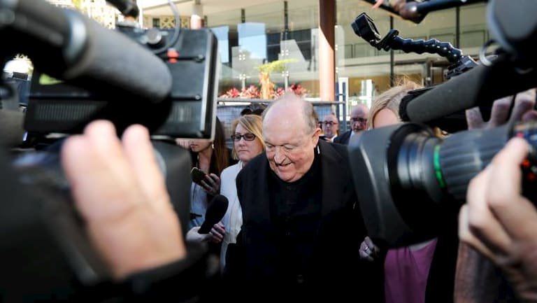 Adelaide Archbishop Philip Edward Wilson leaves court after being found guilty of concealing child sexual abuse.
