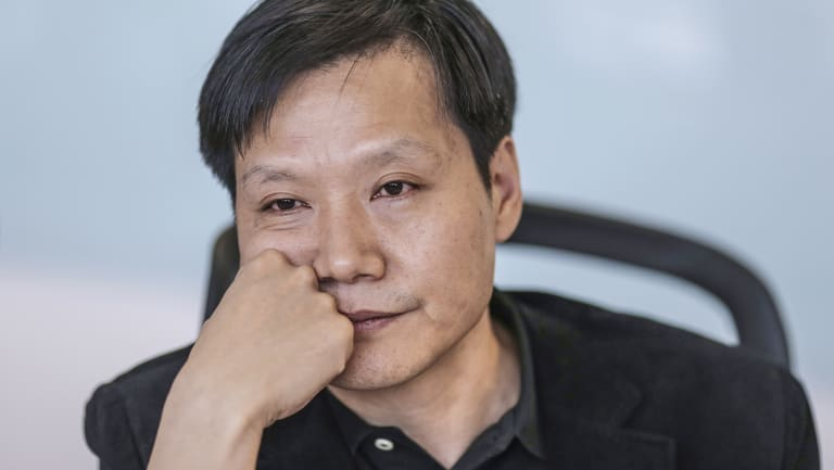 Billionaire Lei Jun, CEO of Xiaomi, cooks for the firm's biggest fans at an annual banquet.
