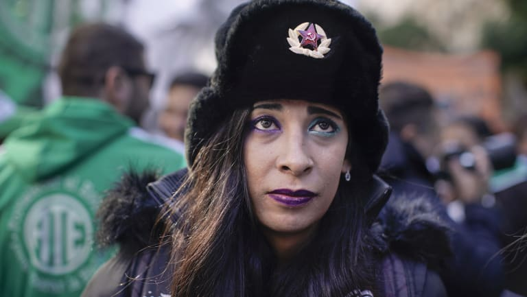 A union activist wears a Russian Soviet army hat during a protest against the Macri's economic policies on Wednesday.