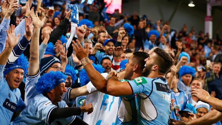 Money-spinner: Jarryd Hayne of the NSW Blues celebrates scoring a try during a State of Origin game..