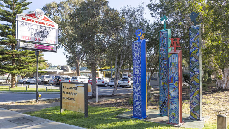 Police say the injured man ran along Fifty Road ran to the school carpark.