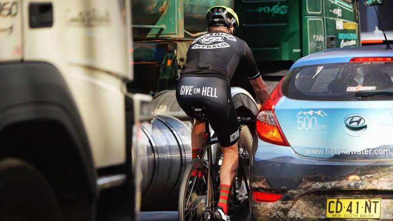 Cyclist in traffic in the Sydney CBD.