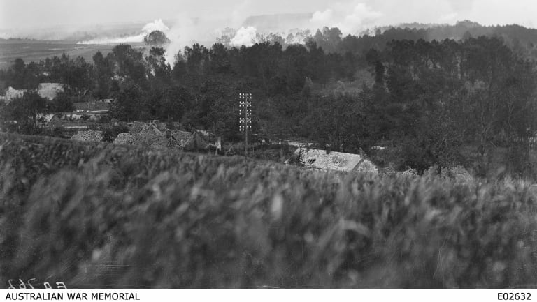 """The view from from the high ground above Sailly-le-Sec. A note by Sergeant A. Brooksbank reads: """"Gas shell bursts. On extreme left, shell exploded some seconds prior to photo, liquid is still evaporating and vapour is keeping close to ground. In centre shells have just exploded; temporary uplift of gas, due to force of explosion is shown."""""""