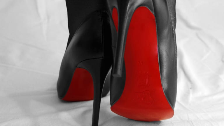 Christian Louboutin has become synonymous with the colour red, thanks to the red soles on his shoes.