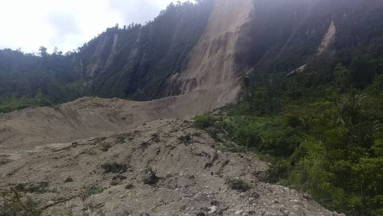 Debris from a massive landslide from Monday's earthquake covers an area in Tabubil township, Papua New Guinea.