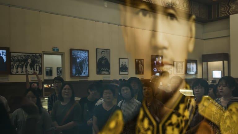 Tourists visit a memorial to Chiang Kai-shek in Taipei, Taiwan.
