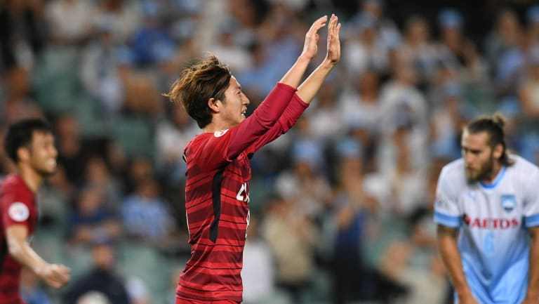 Shoma Doi (centre) of the Antlers reacts after scoring against Sydney during the AFC Champions League Group H match between at Allianz Stadium on Wednesday night.