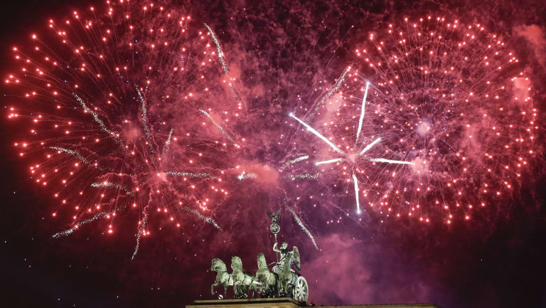 Fireworks light the sky above the Quadriga at the Brandenburg Gate during New Year's celebrations in Berlin.