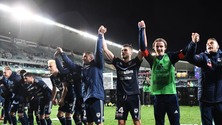 To the Victory goes the spoils: Muscat's team celebrate their passage into the A-League grand final.