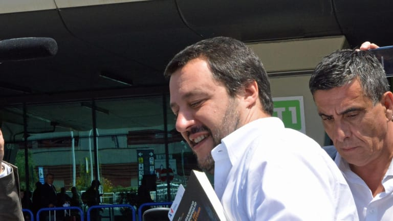 The League leader Matteo Salvini gets in a car as he arrives at Fiumicino airport near Rome.