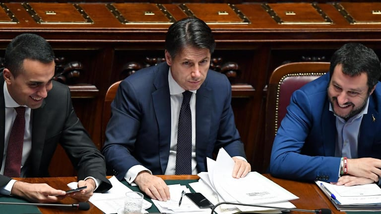 Italian PM Giuseppe Conte is flanked by Interior Minister Matteo Salvini, right, and Labour Minister Luigi Di Maio.