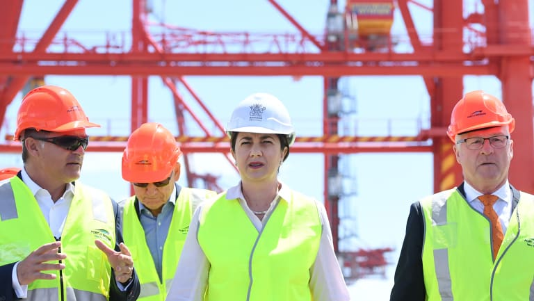 Queensland Premier Annastacia Palaszczuk (centre) and Local Government Association of Queensland president Mark Jamieson (right) are seen at the Port of Brisbane on Wednesday.