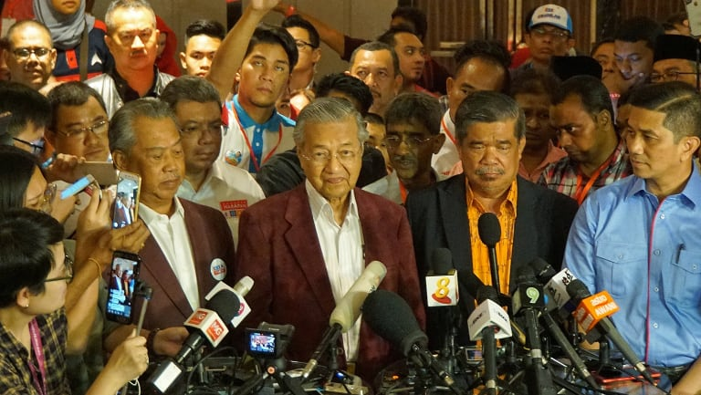 At a late-night conference, Mahathir told reporters it looked like Malaysia would have its first change in government in 61 years.