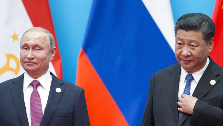 Chinese President Xi Jinping, right, and Russian President Vladimir Putin pose for a photo at the Shanghai Cooperation Organisation Summit in Qingdao in eastern China's Shandong Province.