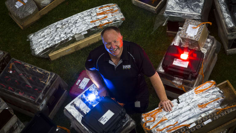 Pyrotechnician Rusty Johnson shows off his fireworks ready to explode over Melbourne's skies for New Year's Eve.