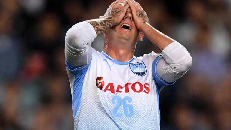 Luke Wilkshire reacts after missing a golden chance.