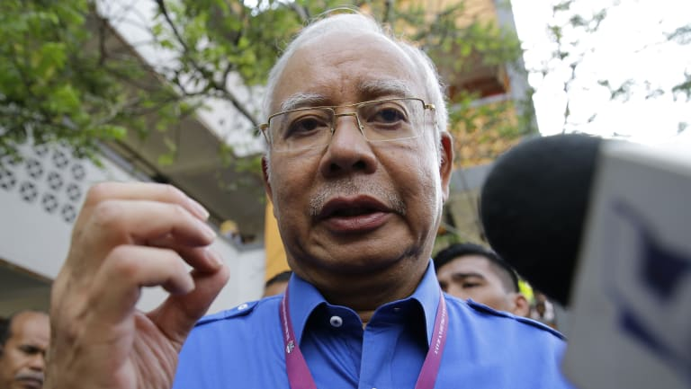 Malaysian Prime Minister Najib Razak talks to reporters after voting.