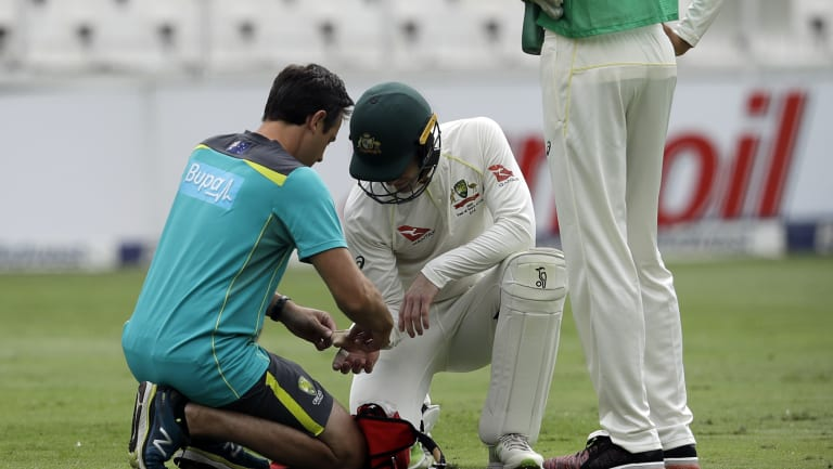 Australian captain Tim Paine receives treatment.