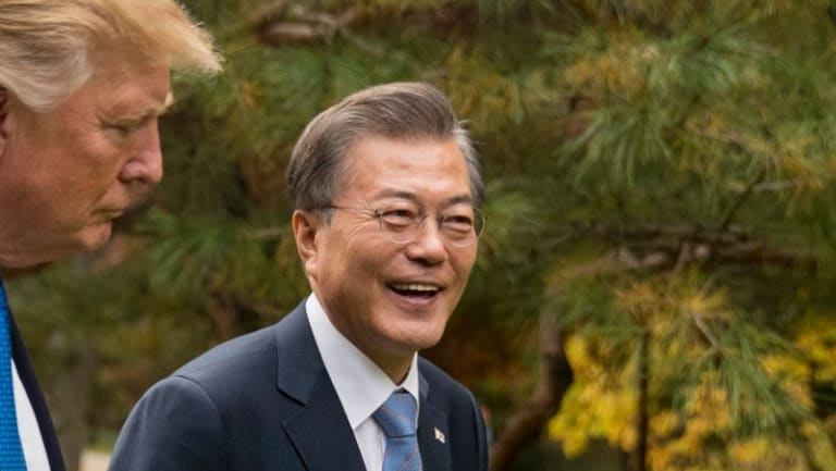 President Donald Trump and South Korean President Moon Jae-in walk through gardens together at the Blue House in Seoul in November.