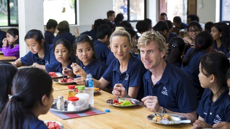 Founders Agnieszka Tynkiewicz-Gile and Trevor Gile with Liger students.