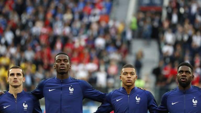 Speaking our language: Antoine Griezmann, Paul Pogba, Kylian Mbappe, and Samuel Umtiti sining the French anthem.