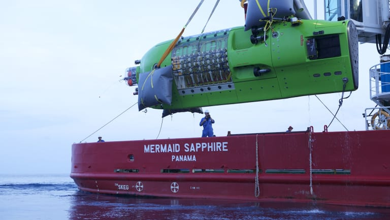 The Deepsea Challenger being lifted into the water.