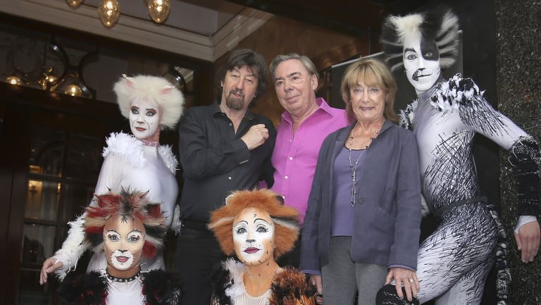 (Centre left to right) Trevor Nunn, Andrew Lloyd Webber and Gillian Lynne with performers from the musical Cats outside the London Palladium, 2014. in central London.