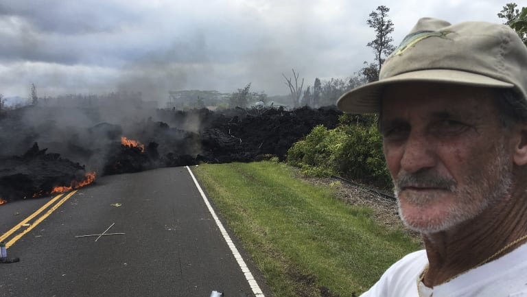 Lava flowing over Mohala Street in the Leilani Estates.