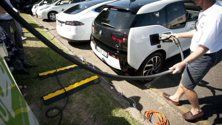 Filling up at an electric vehicle charging station in Brisbane.