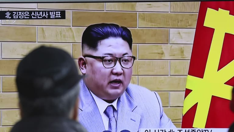 South Koreans watch a TV news program showing North Korean leader Kim Jong-un's New Year's speech.