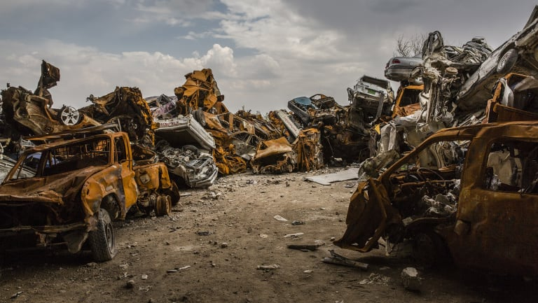 Cars destroyed during the fight for Mosul are piled up on the outskirts of the Old City in the west.