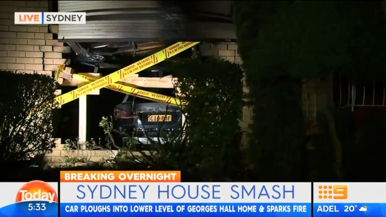 A 21-year-old has been arrested after allegedly crashing his car into a home in Sydney's south-west, causing it to burst into flames, police report.