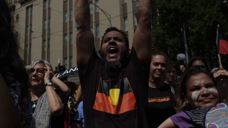 An 'invasion day' protester in Melbourne.
