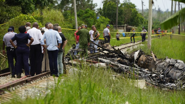 Rescue and search workers on the site where a Cuban airliner with more than 100 passengers on board crashed.